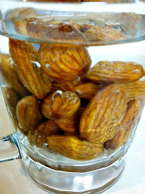 soak raw almonds in pure water about 6-8 hours. Jackets will release easily as well.
